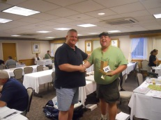 Ted Wilcox receives the first place prize for the Saturday Mini!